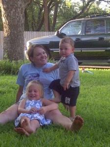 Mama, Merritt and Caleb in the grass