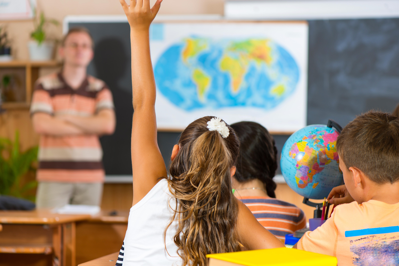 School Girl Raising Hand.jpeg